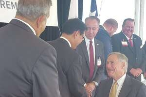Texas Gov. Greg Abbott, right, shakes hands with Kazuhisa Osaki, Aisin AW president, during the Nov. 4 ground-breaking ceremony for the firm'\'s $400 million automatic transmission plant in Cibolo.