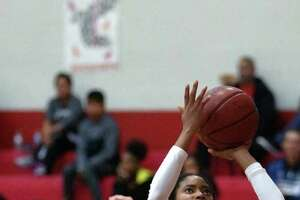 Judson's Teanna  Huggins (2) goes  over Laredo United South's Millie Hernandez during Judson's 38-23 home win to open their 2019 season.