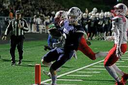 Central Catholic wide receiver Aidan O'Connel scores a touchdown on Friday, at Bob Benson Stadium. The Apaches defeated the Buttons, 41-38.