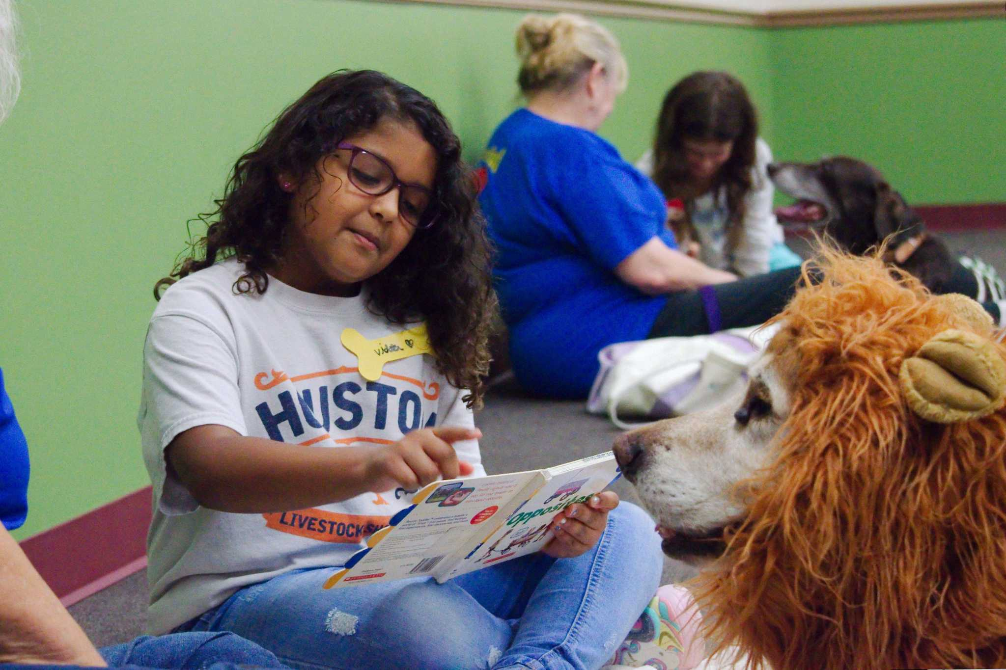 Kids hone skills reading to furry 'listeners' at League City library