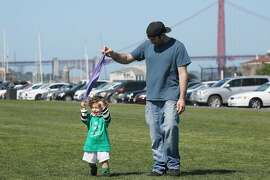 Paolo DeLosa-Tham, with his son while on California's paid leave, at a water front park in San Francisco, on April 5, 2016.  A new study conducted in California, which in 2004 became the first state to offer paid family leave, found new mothers who took it that year ended up working less and earning less a decade later and averaged $24,000 in cumulative lost wages. (Jim Wilson/The New York Times)