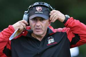 Wilbur Cross head coach John Acquavita on the sideline against Amity Thursday, September 27, 2018, at Johnson Field at the Dr. William E. Sim Athletic Complex at Amity Regional High School in Woodbridge. The Spartans won, 27-12.