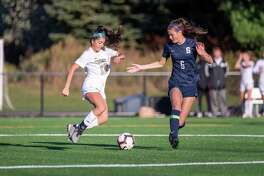 Truymbull High's Korrie Munoz and Staple High's Mia Gonzalez during the FCIAC Girls Soccer Tournament Quarterfinal, Friday, November 1, 2019, at at Wakeman Park in Westport, CT