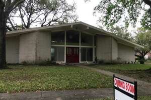 """A house with a """"coming soon"""" sign in the Sharpstown area."""