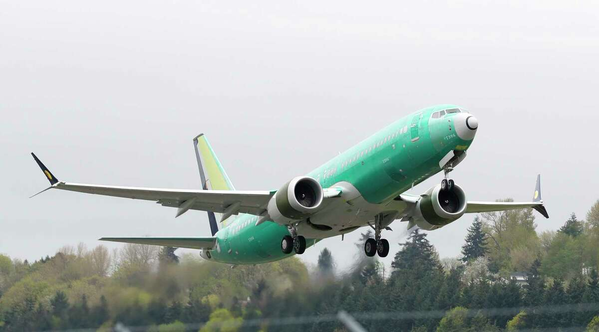 FILE - In this April 10, 2019, file photo a Boeing 737 MAX 8 airplane being built for India-based Jet Airways, takes off on a test flight at Boeing Field in Seattle. Boeing hopes to resume deliveries of its 737 Max jet to airlines in December and win regulatory approval to restart commercial service with the plane in January. Boeing shares rose in midday trading Monday, Nov. 11. (AP Photo/Ted S. Warren, File)
