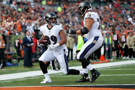 Tight end Mark Andrews scores one of the Ravens' three passing touchdowns against Cincinnati.