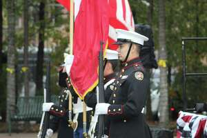 About 100 people gathered Monday, Nov. 11, to honor and remember the veterans of all branches of the military at The Woodlands Township Veterans Day Tribute. The Junior ROTC Honor Guard from College Park High School did the presentation of colors.