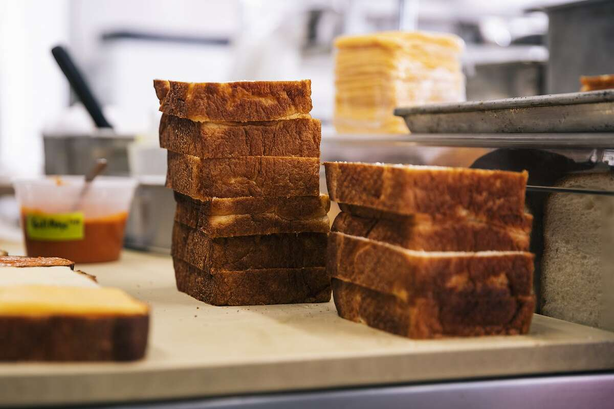 Slices of milk bread for the grilled cheese sandwich are seen inside the Breadbelly kitchen on Monday, Nov. 4, 2019 in San Francisco, California.
