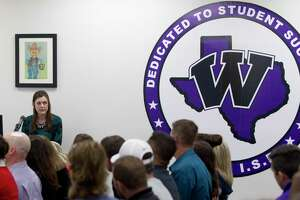 Willis High School Principal Stephanie Hodgins speaks during the public comment portion of a Willis ISD school board meeting, Monday, Nov. 11, 2019, in Willis. Members of the public shared their views after the district hosted a Houston-area drag queen for a make-up application lesson for cosmetology students in October. Conroe ISD Board Trustee Dale Inman initially spoke out against the district, and is claiming district officials are now retaliating against his wife, Kelley, who teaches in the district.