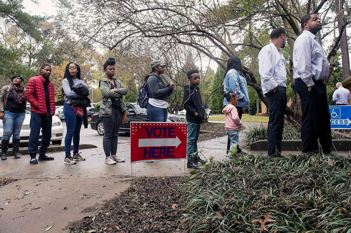 People line up to vote on election day in November 2018 in Fairburn, Ga. (Brian Cahn/Zuma Press/TNS)
