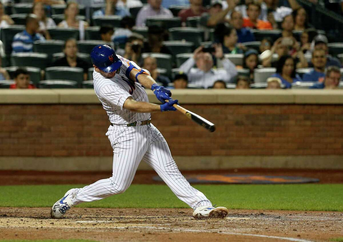 NEW YORK, NEW YORK - SEPTEMBER 28: Pete Alonso #20 of the New York Mets connects on his third inning home run against the Atlanta Braves at Citi Field on September 28, 2019 in New York City. The home run was Alonso's 53rd of the season, breaking Aaron Judge's rookie record. (Photo by Jim McIsaac/Getty Images)