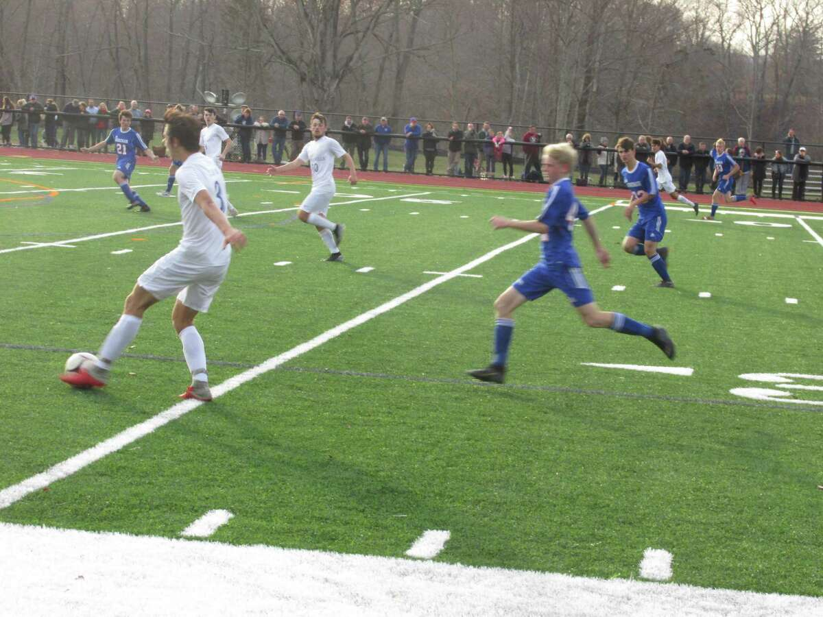 Lewis Mills (white uniforms) controlled the ball in the Class M first round at Nonnewaug High School, but stiff defense and a great first-year goalkeeper held on to the Chiefs' win Monday afternoon.