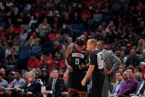 Houston Rockets guard James Harden (13) looks at the replay screen above as he challenges referee John Goble (30) after being called for a foul in the first half of an NBA basketball game against the New Orleans Pelicans in New Orleans, Monday, Nov. 11, 2019. (AP Photo/Gerald Herbert)