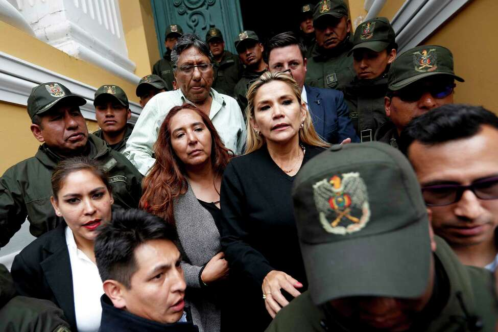 Senate second Vice President Yanine Anez, center right, arrives to Congress in La Paz, Bolivia, Monday, Nov. 11, 2019. Bolivian President Evo Morales' Nov. 10 resignation, under mounting pressure from the military and the public after his re-election victory triggered weeks of fraud allegations and deadly demonstrations, leaves a power vacuum and a country torn by protests against and for his government. (AP Photo/Natacha Pisarenko)