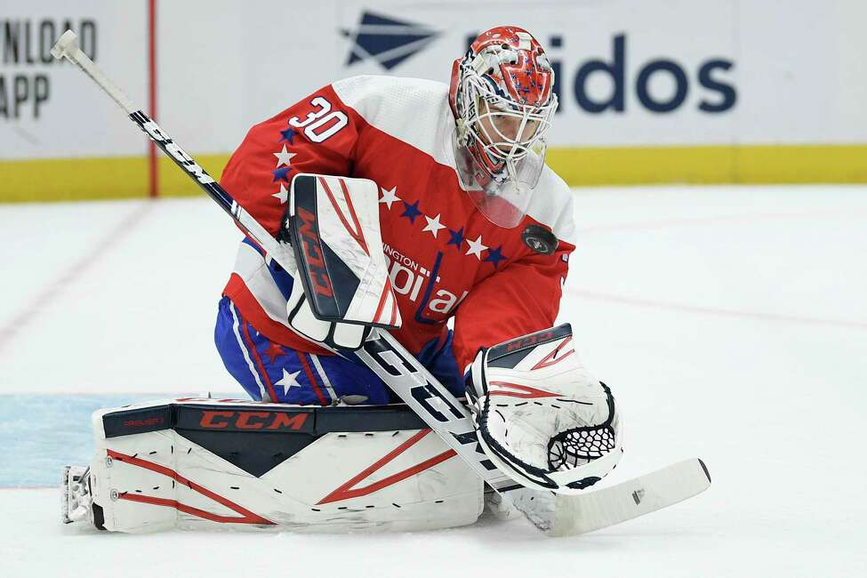 Washington Capitals goaltender Ilya Samsonov (30), of Russia, keeps his eye on the puck during the first period of an NHL hockey game against the Arizona Coyotes, Monday, Nov. 11, 2019, in Washington. (AP Photo/Nick Wass)