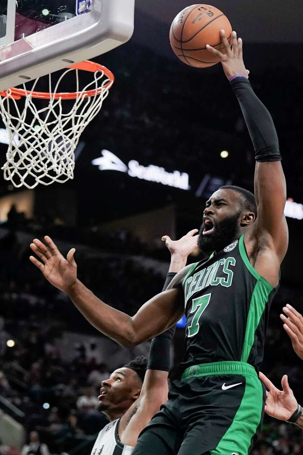 Boston Celtics' Jaylen Brown shoots during the second half of an NBA basketball game against the San Antonio Spurs, Saturday, Nov. 9, 2019, in San Antonio. (AP Photo/Darren Abate)