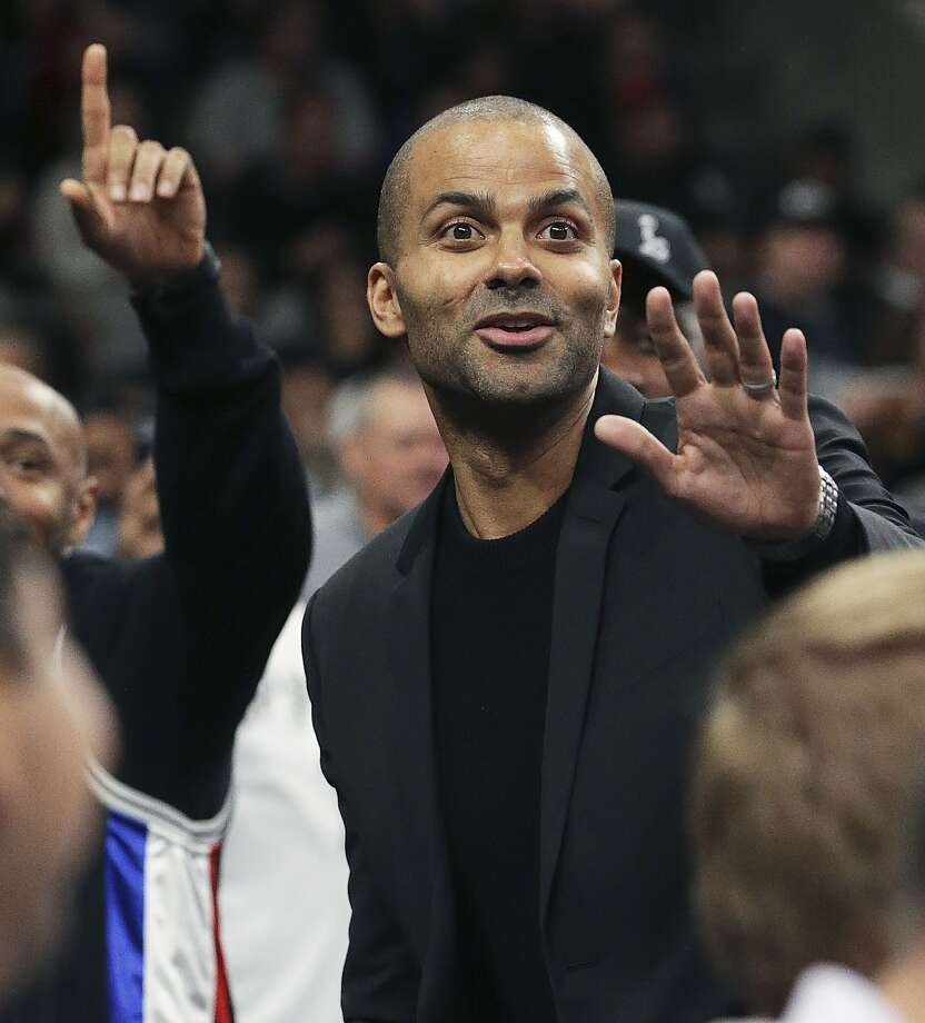 Tony Parker takes a peek out from the locker room runway at fans during the first half as the Spurs host the Grizzlies on the night of the Tony Parker jersey retirement ceremony at the AT&T Center on Nov. 11, 2019. Photo: Tom Reel, Staff Photographer
