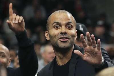 Tony Parker takes a peek out from the locker room runway at fans during the first half as the Spurs host the Grizzlies on the night of the Tony Parker jersey retirement ceremony at the AT&T Center on Nov. 11, 2019.