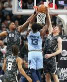Rudy Gay and Jakob Poeltl contest a shot by Jaren Jackson as the Spurs host the Grizzlies on the night of the Tony Parker jersey retirement ceremony at the AT&T Center on Nov. 11, 2019.