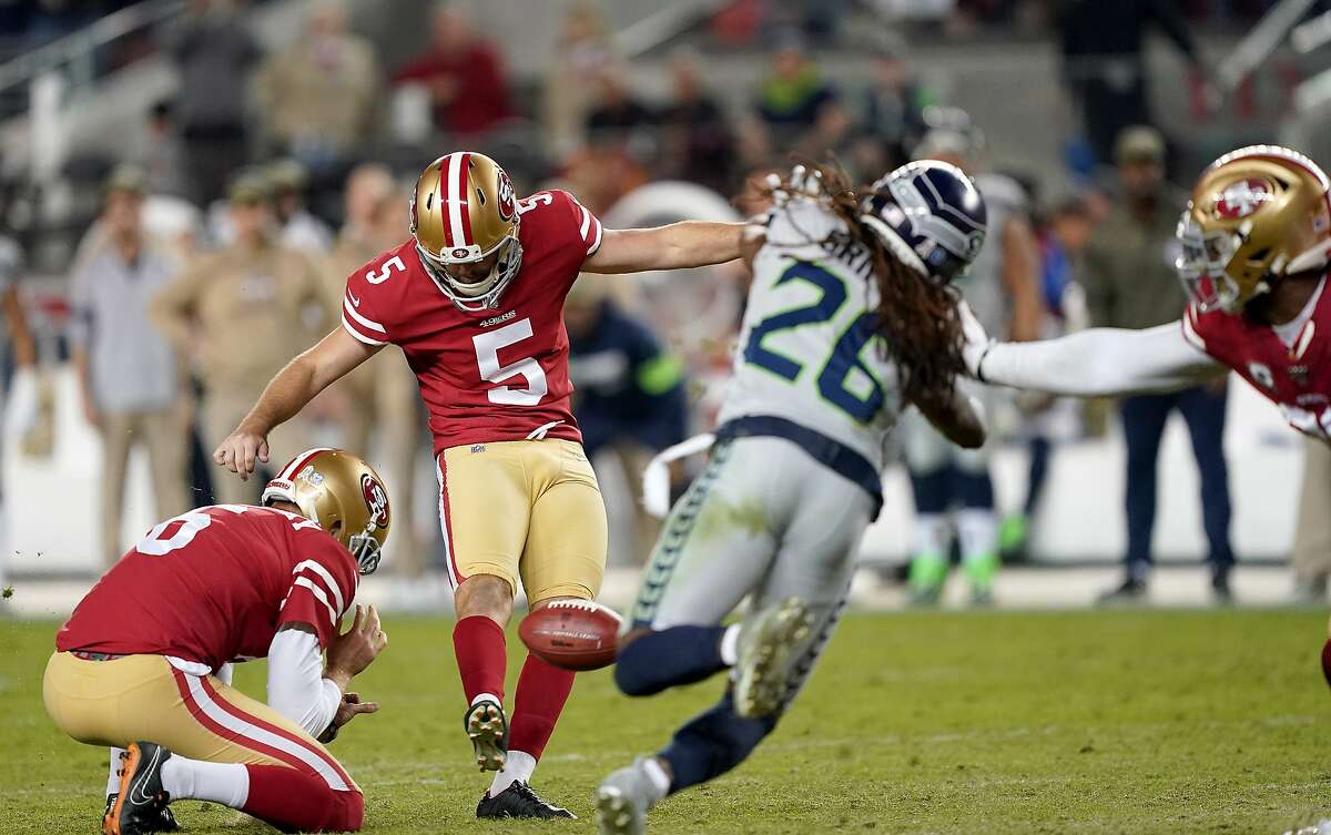 Kicker Chase McLaughlin #5 of the San Francisco 49ers kicks a 47 yard field goal to tie the game 24-24 to end the fourth quarter taking the game in to overtime against the Seattle Seahawks at Levi's Stadium on November 11, 2019 in Santa Clara, California.