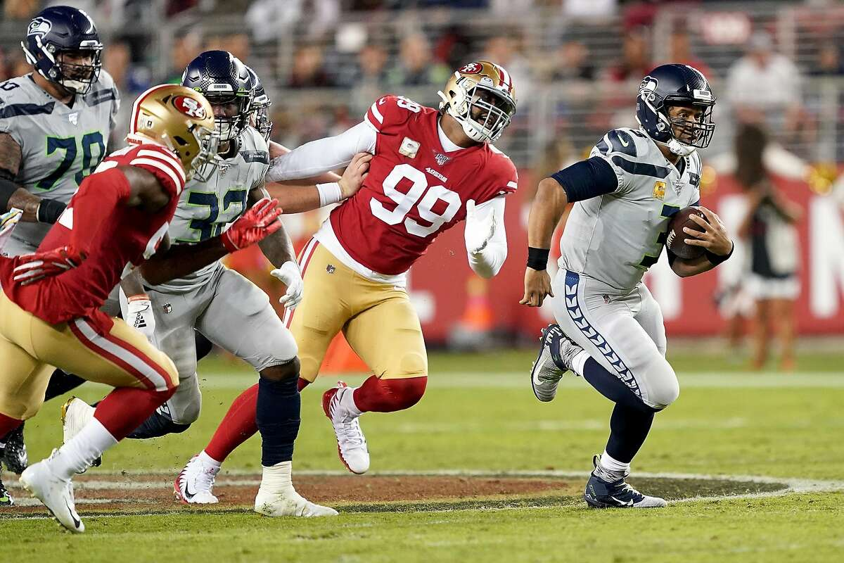 SANTA CLARA, CALIFORNIA - NOVEMBER 11: Quarterback Russell Wilson #3 of the Seattle Seahawks scrambles against the defense of the San Francisco 49ers at Levi's Stadium on November 11, 2019 in Santa Clara, California. (Photo by Thearon W. Henderson/Getty Images)
