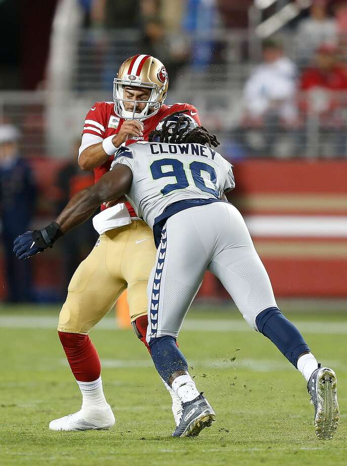 SANTA CLARA, CALIFORNIA - NOVEMBER 11: Quarterback Jimmy Garoppolo #10 of the San Francisco 49ers is tackled by Jadeveon Clowney #90 of the Seattle Seahawks in the first quarter at Levi's Stadium on November 11, 2019 in Santa Clara, California. (Photo by Lachlan Cunningham/Getty Images) Photo: Lachlan Cunningham / Getty Images