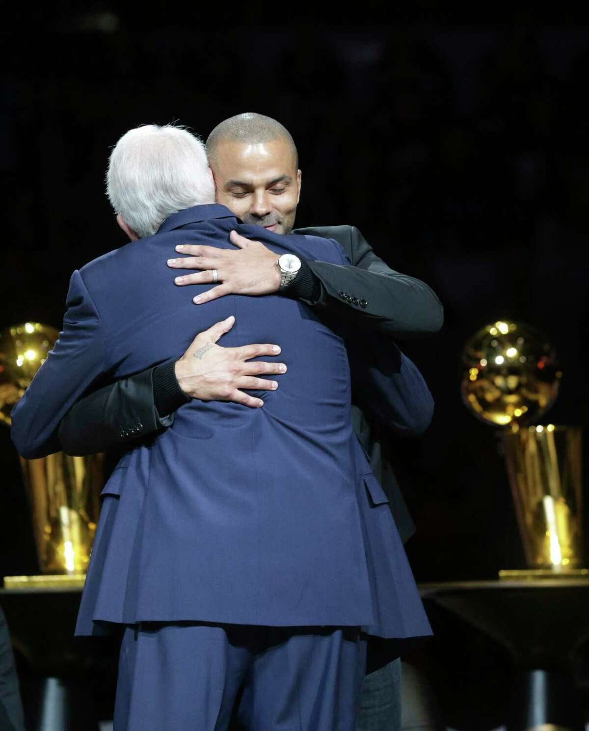 Merci, Tony! Spurs star Tony Parker gets a hug during his recent jersey retirement ceremony. A reader is proud of the Spurs - a team recognized around the world.