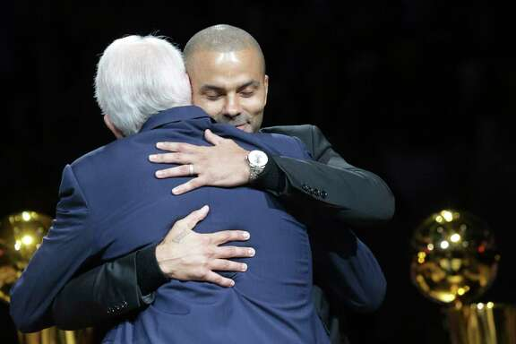 Merci, Tony! Spurs star Tony Parker gets a hug during his recent jersey retirement ceremony. A reader is proud of the Spurs — a team recognized around the world.