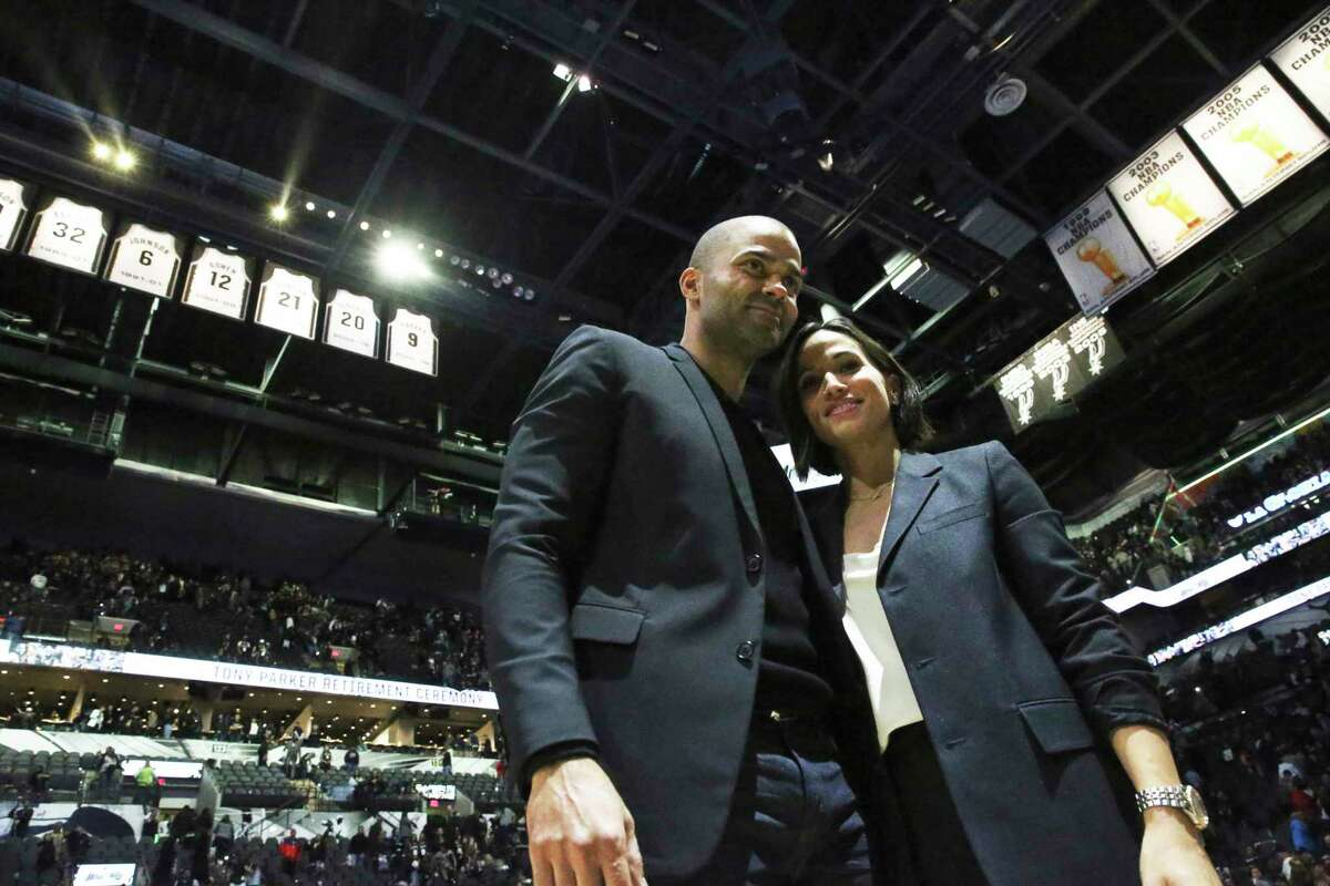 Tony Parker stands with wife Axelle Francine after Parker's jersey retirement ceremony at the AT&T Center on Nov. 11, 2019.