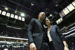 Tony Parker stands with wife Axelle Francine after the speeches on the night of the Tony Parker jersey retirement ceremony at the AT&T Center on Nov. 11, 2019.