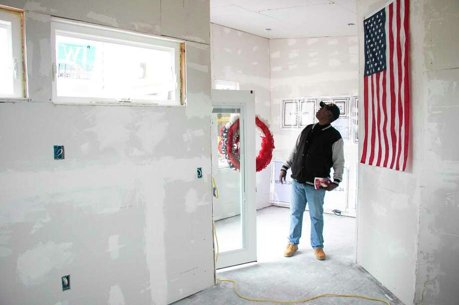 "Mark Valyan, who retired from the Navy, explored the Tiny House built by Summer Creek High School students for an unknown homeless veteran as part of their program ""Students Helping Veterans: Big Heroes, Tiny Homes."" Photo: Savannah Mehrtens/Staff Photo / Savannah Mehrtens/Staff Photo"