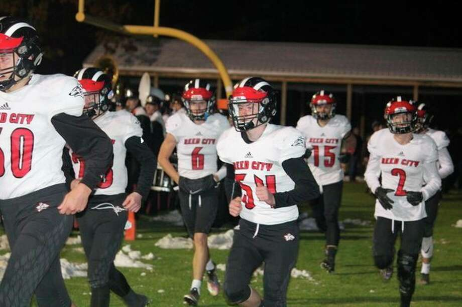 Reed City football players enter the field for the playoff game against Kingsley. (Herald Review/John Raffel)