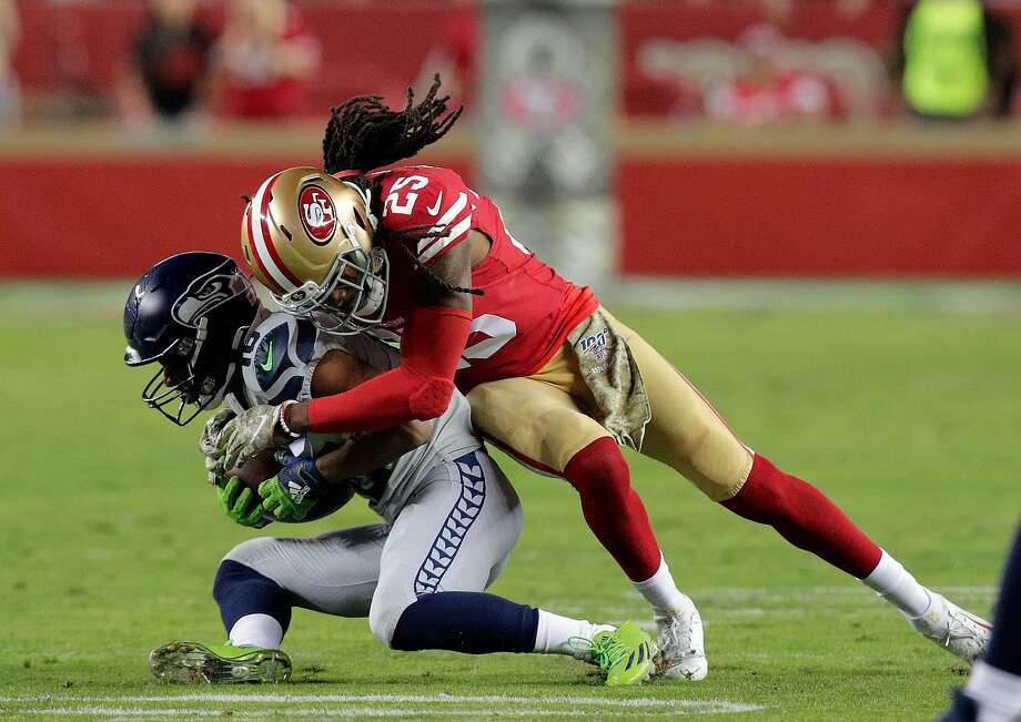 Richard Sherman (25) tackles Tyler Lockett (16) after a catch in the first half as the San Francisco 49ers played the Seattle Seahawks at Levi's Stadium in Santa Clara, Calif., on Monday, November 11/11/19, 2019. Photo: Carlos Avila Gonzalez, The Chronicle