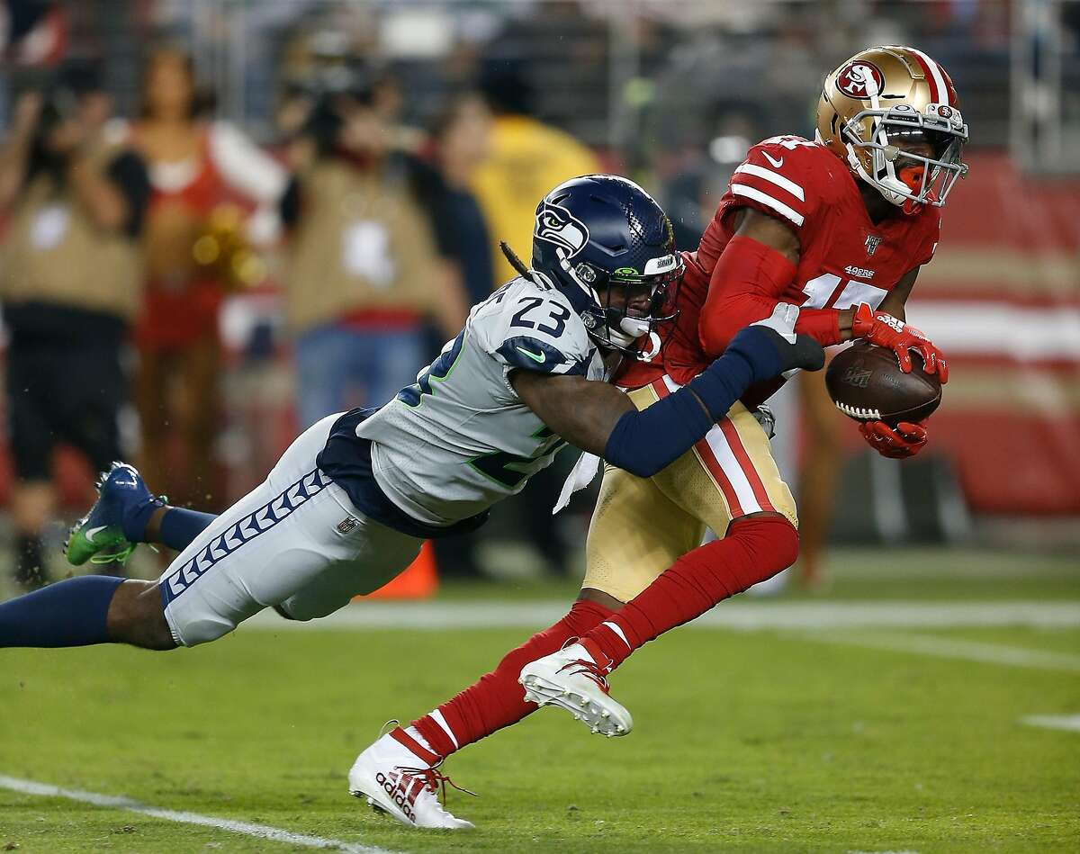 SANTA CLARA, CALIFORNIA - NOVEMBER 11: Emmanuel Sanders #17 of the San Francisco 49ers is tackled by Neiko Thorpe #23 of the Seattle Seahawks in the first quarter at Levi's Stadium on November 11, 2019 in Santa Clara, California. (Photo by Lachlan Cunningham/Getty Images) ***BESTPIX***