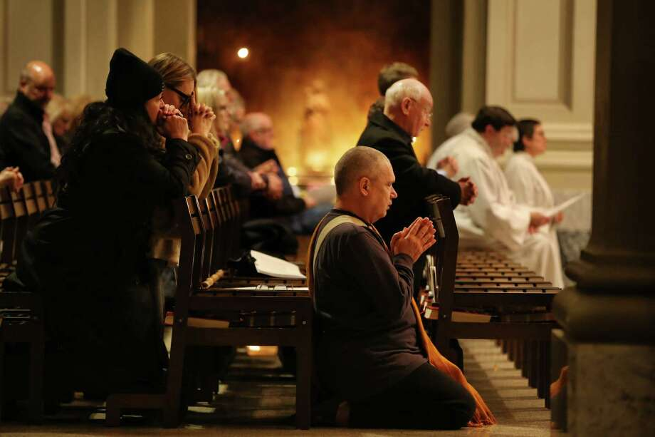 Parishioners gather at St. James Cathedral for a mass in remembrance of the deceased homeless of Seattle, Nov. 7, 2019. The congregation, led by Father Michael Ryan, honored the 169 homeless who died in Seattle in the past year. Photo: Genna Martin, Seattlepi.com / GENNA MARTIN