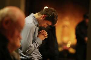 Parishioners gather at St. James Cathedral for a mass in remembrance of the deceased homeless of Seattle, Nov. 7, 2019. The congregation, led by Father Michael Ryan, honored the 169 homeless who died in Seattle in the past year.