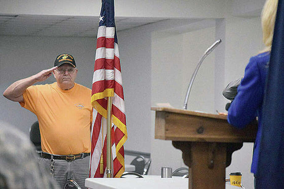 Ron Gilbert of Jacksonville salutes the flag Monday during a Veterans Day ceremony. The event was moved from Community Park to AmVets Post 100 because of inclement weather. Photo: Samantha McDaniel-Ogletree | Journal-Courier