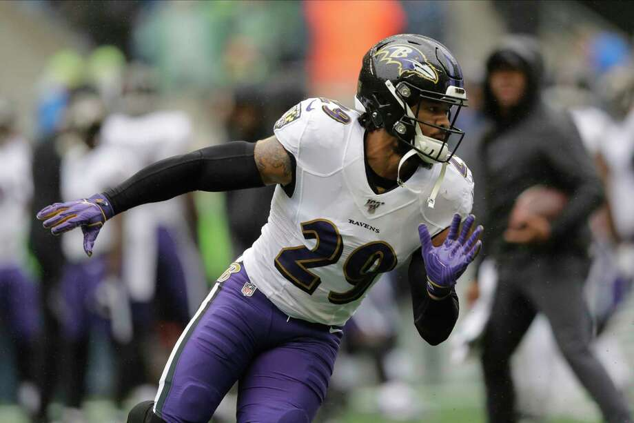 PHOTOS: Texans vs. Jaguars in London  Baltimore Ravens free safety Earl Thomas runs on the field during warmups before an NFL football game against the Seattle Seahawks, Sunday, Oct. 20, 2019, in Seattle. (AP Photo/John Froschauer)  >>>Look back at photos from the Texans' win in London ....  Photo: John Froschauer, Associated Press / Copyright 2019 The Associated Press. All rights reserved.