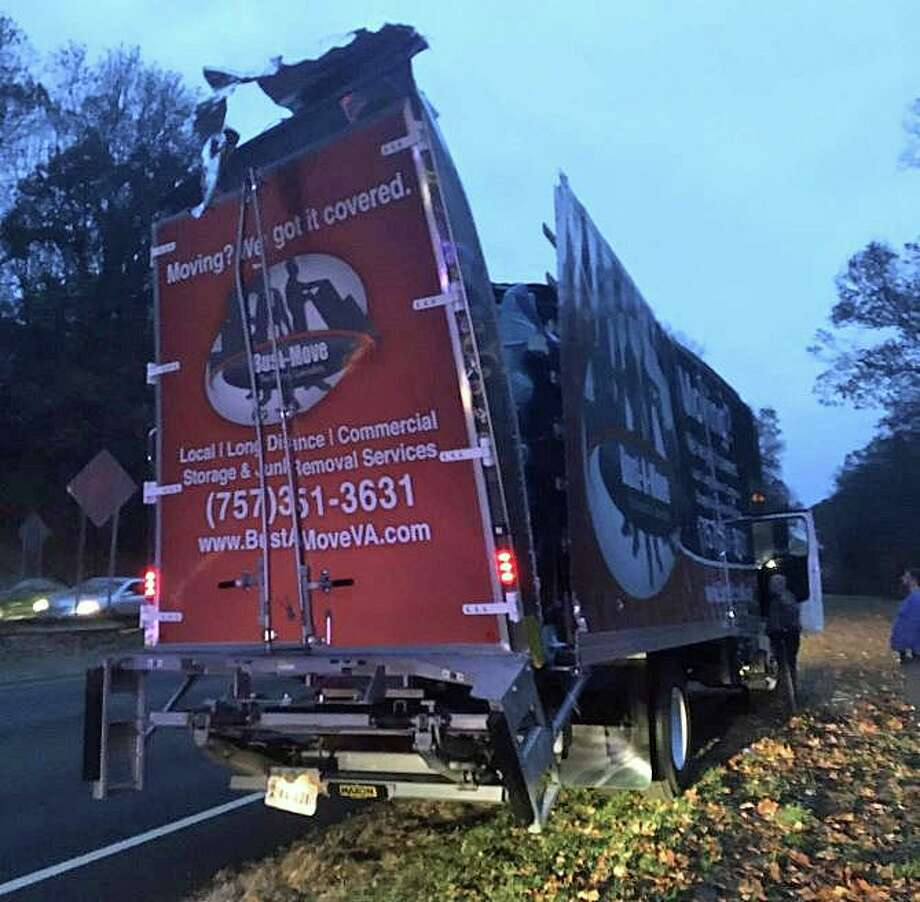 The driver of a tractor-trailer truck will be getting a ticket after his vehicle slammed into a bridge over the Merritt Parkway in Norwalk on Tuesday, Nov. 12, 2019. Photo: State Police Photo