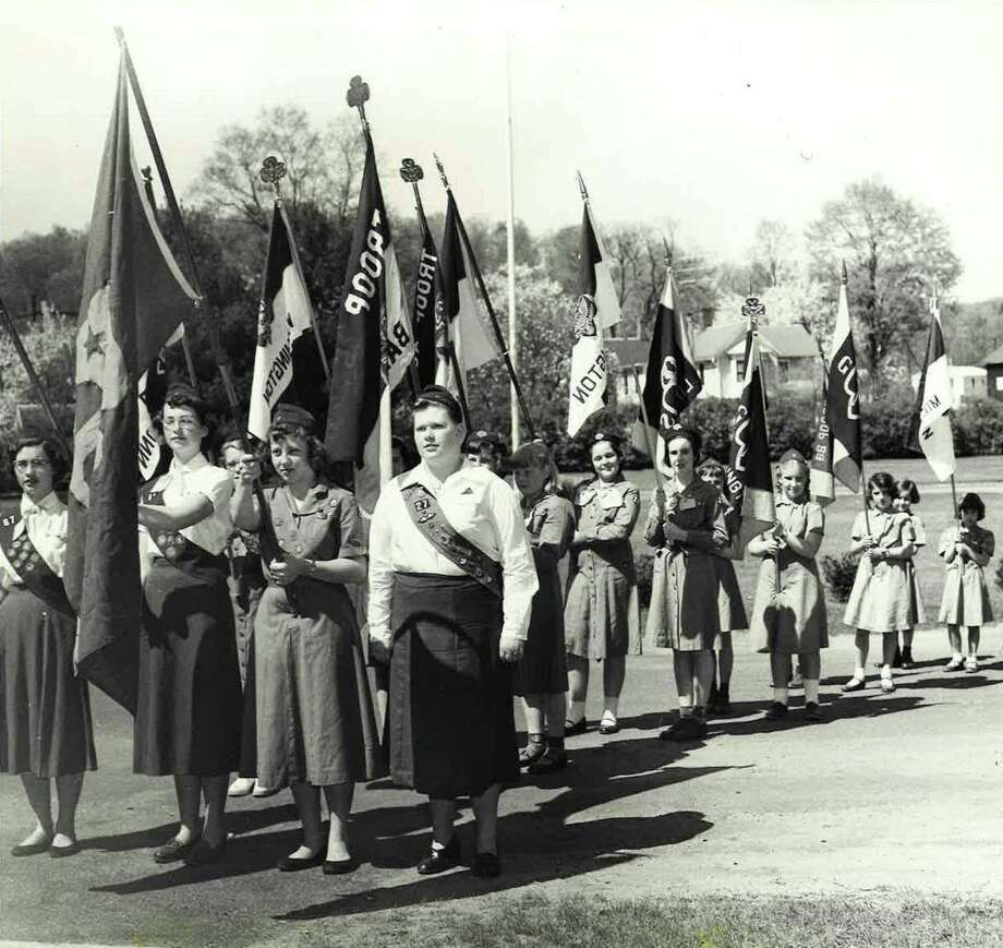 """Spectrum/ Girl Scouts have long played a role in the Greater New Milford area. Above, Scouts are shown at a District I Rally in Washington Depot on May 11, 1955. The Girl Scouts and other recreational programs in Washington, including leisure activities, entertainment at recreation hall in the town hall, little league, swimming lessons, park and recreation, nature walks, Boy Scouts, New Preston Boys and Girls Club and more, will be discussed at the next Gunn Historical Museum's Washington History Club at Night Nov. 19 at 6:30 p.m. Attendees are invited to meet at 5:30 p.m. to view the museum's new exhibit, """"Washington ,Connecticut: An American Story."""" If you have a """"Flashback"""" photograph you'd like to share, contact Deborah Rose at drose@newstimes.com or 860-355-7324. For Flashback 11/15/19  Courtesy of Gunn Historical Museum Photo: Contributed Photo / The News-Times Contributed"""