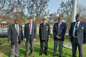 Veterans from the Darien Veterans of Foreign Wars Post 6933 on Noroton Avenue were honored in Darien's Veterans Day ceremony. From left, Larry Hunter, John Driscoll, Pete Kenyon, Dennis Clayburn, and Lenny Hunter.