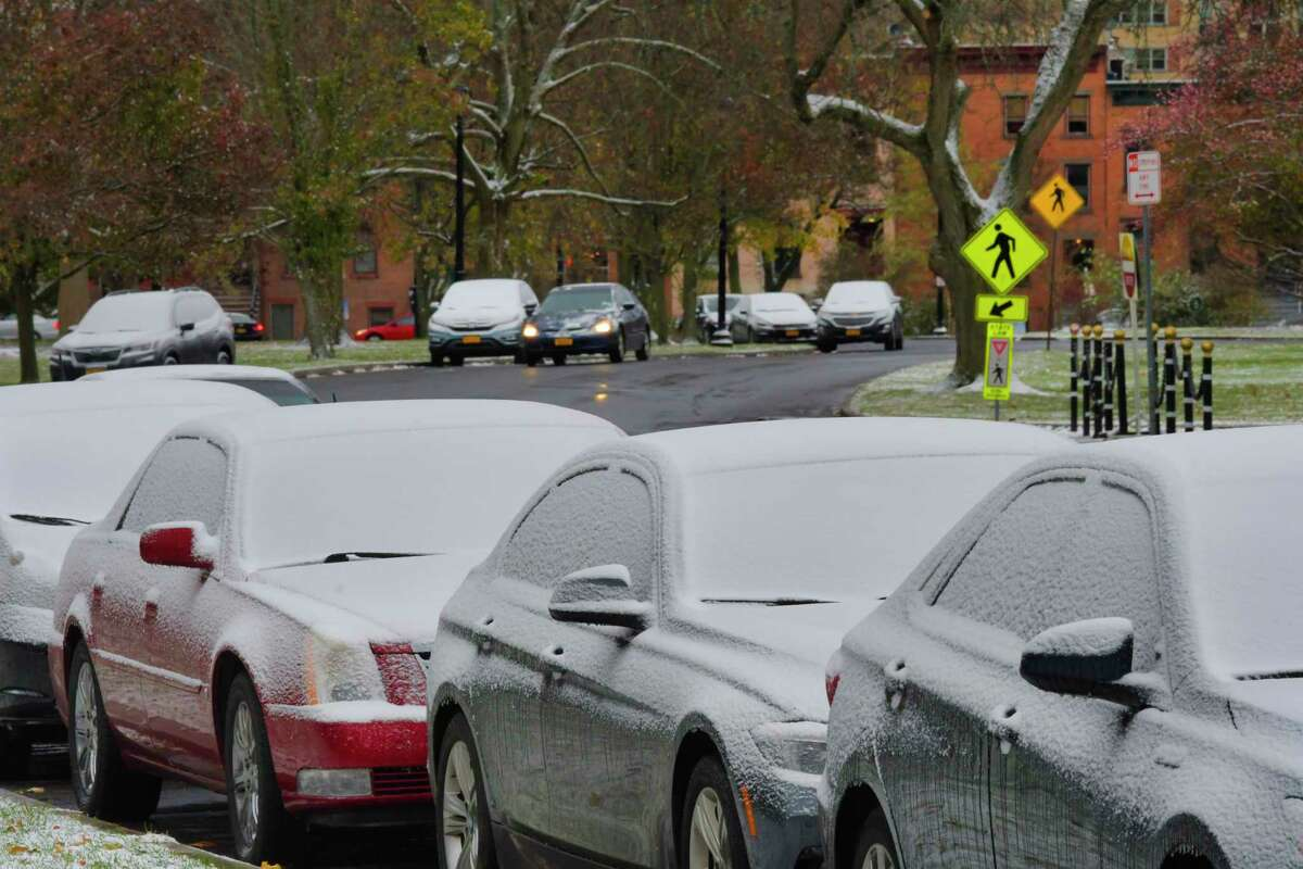 Cars covered in fresh snow on Henry Johnson Blvd. on Tuesday, Nov. 12, 2019, in Albany, N.Y. (Paul Buckowski/Times Union)