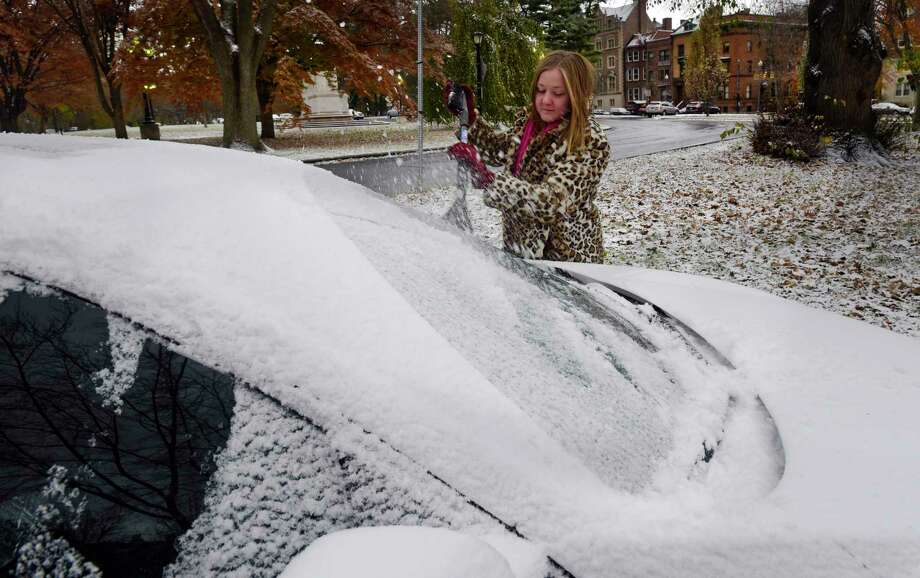 Elizabeth Murad of Albany cleans snow and ice off of her car on Tuesday, Nov. 12, 2019, in Albany, N.Y.  (Paul Buckowski/Times Union) Photo: Paul Buckowski, Albany Times Union / (Paul Buckowski/Times Union)
