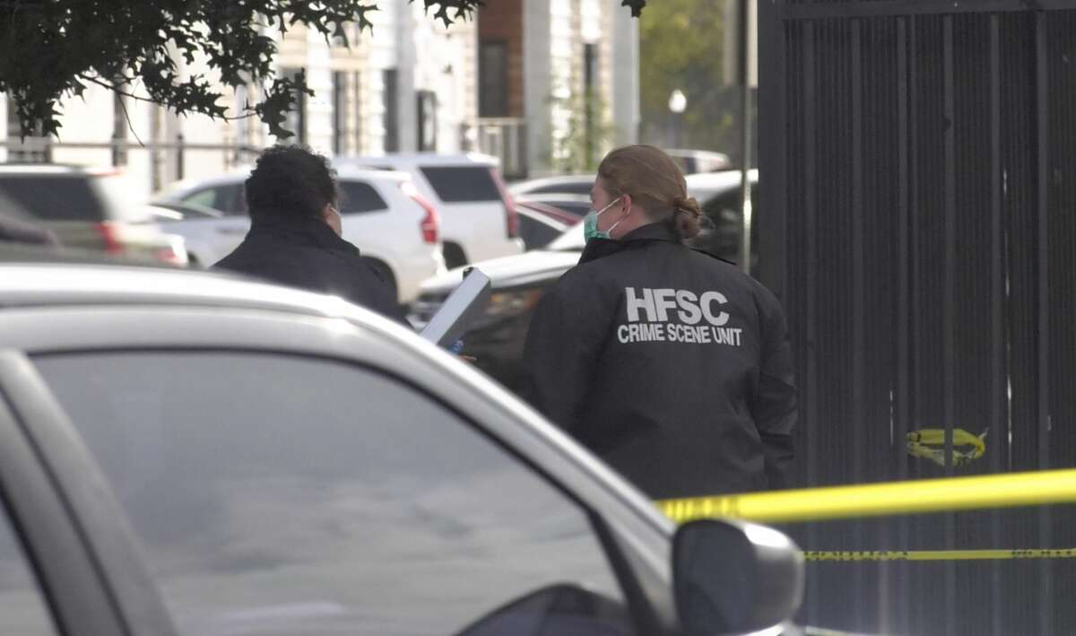 Houston police investigate the discovery of a man's body, who appeared to suffer from head trauma, in the 1900 block of Commerce Street on Tuesday, Nov. 12, 2019.