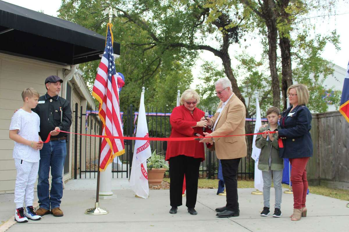 Lori Klein Quinn and David R. Quinn cut the ribbon on the new Veterans Memorial Garden at Klein Wealth Management in Tomball on Nov. 11, 2019.