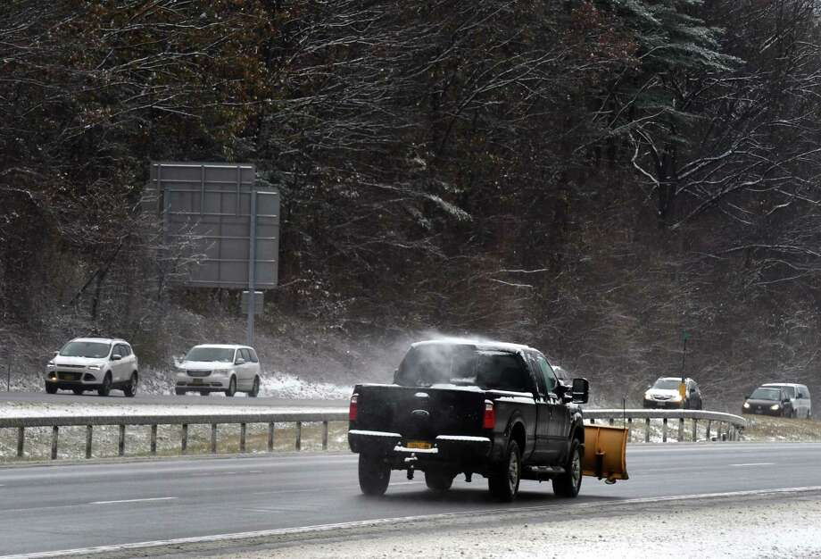 Snowplow operators head up the Northway northbound near Exit 9 on Tuesday, Nov. 12, 2019, in Clifton Park, N.Y. (Will Waldron/Times Union) Photo: Will Waldron, Albany Times Union