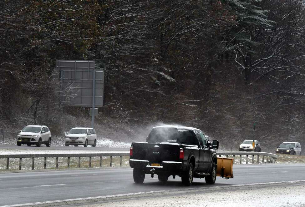 Snowplow operators head up the Northway northbound near Exit 9 on Tuesday, Nov. 12, 2019, in Clifton Park, N.Y. (Will Waldron/Times Union)