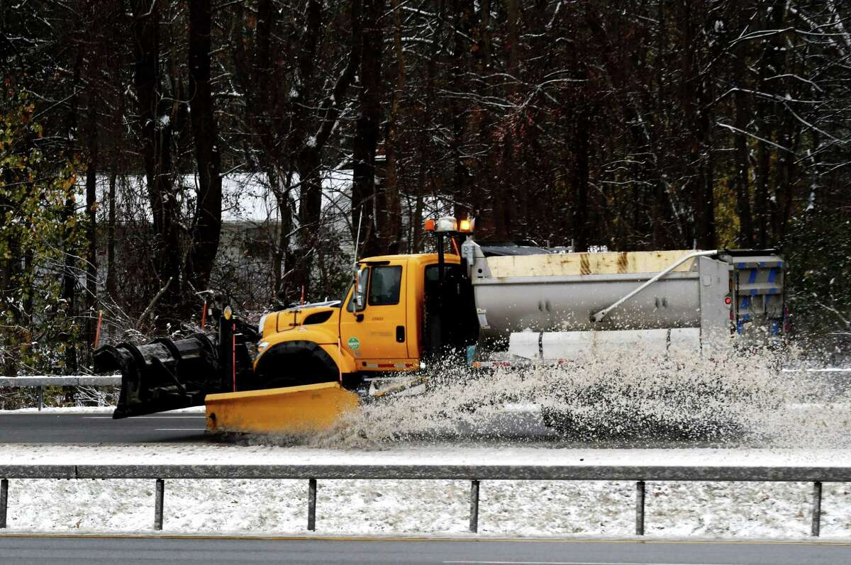 A New York State Department of Transportation snowplow cuts a path through the Northway southbound near Exit 9, as the Capital Region experiences its first taste of snow for the season on Tuesday, Nov. 12, 2019, in Clifton Park, N.Y. (Will Waldron/Times Union)