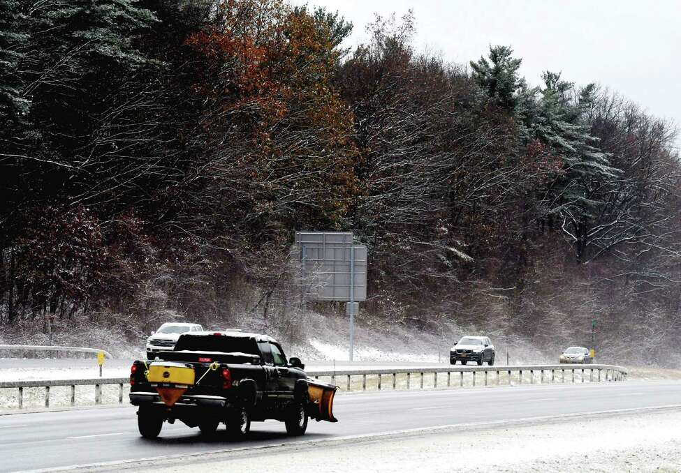 Snowplow operators head up the Northway northbound near Exit 9, as the Capital Region experiences its first taste of snow for the season on Tuesday, Nov. 12, 2019, in Clifton Park, N.Y. (Will Waldron/Times Union)