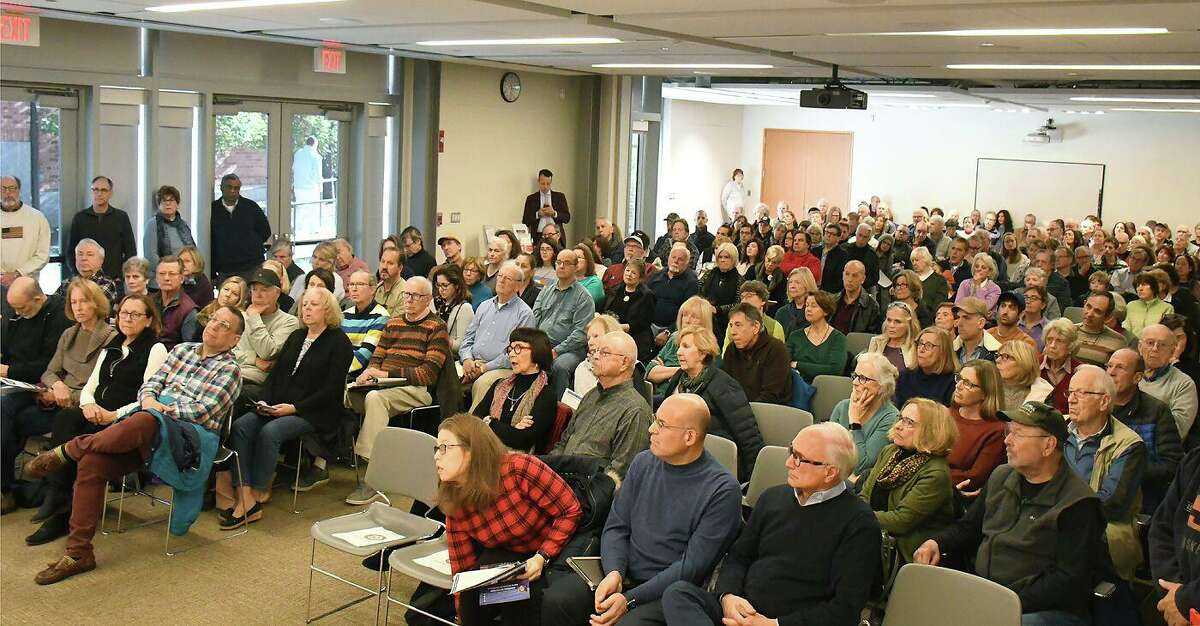 A crowd of Ridgefield residents listens to Congressman Jim Himes at the Ridgefield Library on Saturday, Nov. 9.